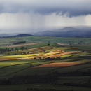 Blaze and Barrock Fells in North Eden Valley with Rain beyond over the Solway Firth and Carlisle