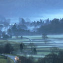 Grasmere, Christmas Eve, cold evening fog mist flowing down from fells into Lake District village