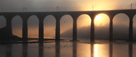 Royal Border Bridge, Berwick-Upon-Tweed with shafts of evening sunlight through mist (sea fret)