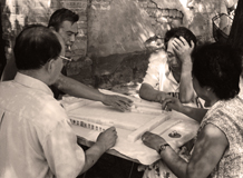 People playing mahjong in  a street in Beijing hutong, China, 2000